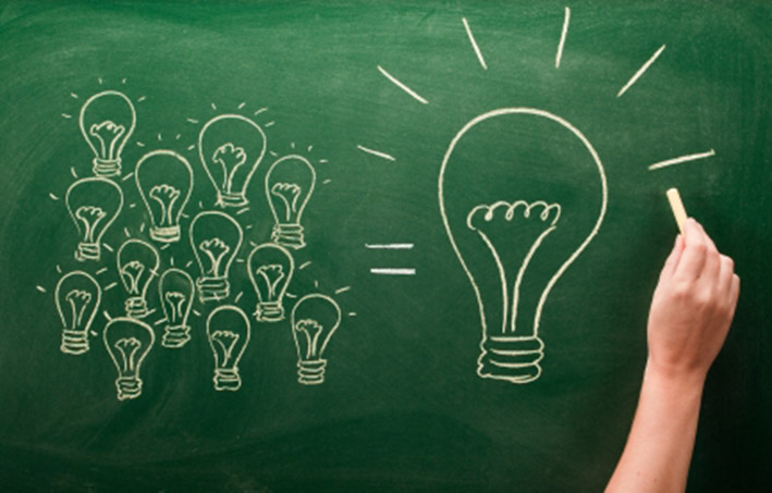 Digital indentity, light bulbs sketched on chalkboard, Many small ideas make a big one